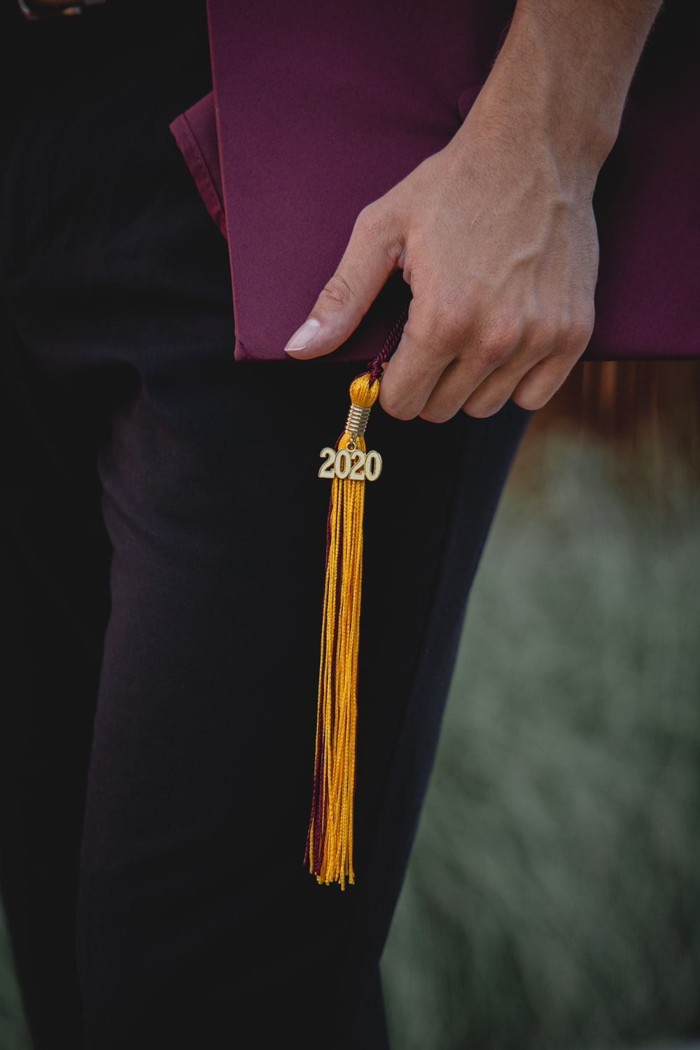 person holding gold and black belt buckle