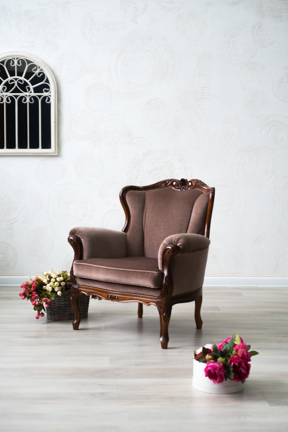 brown leather armchair beside pink roses