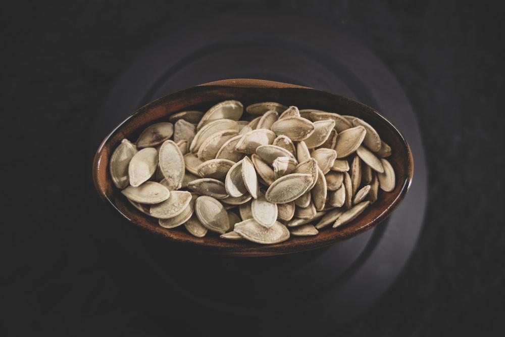 pumpkin seeds in a ceramic bowl