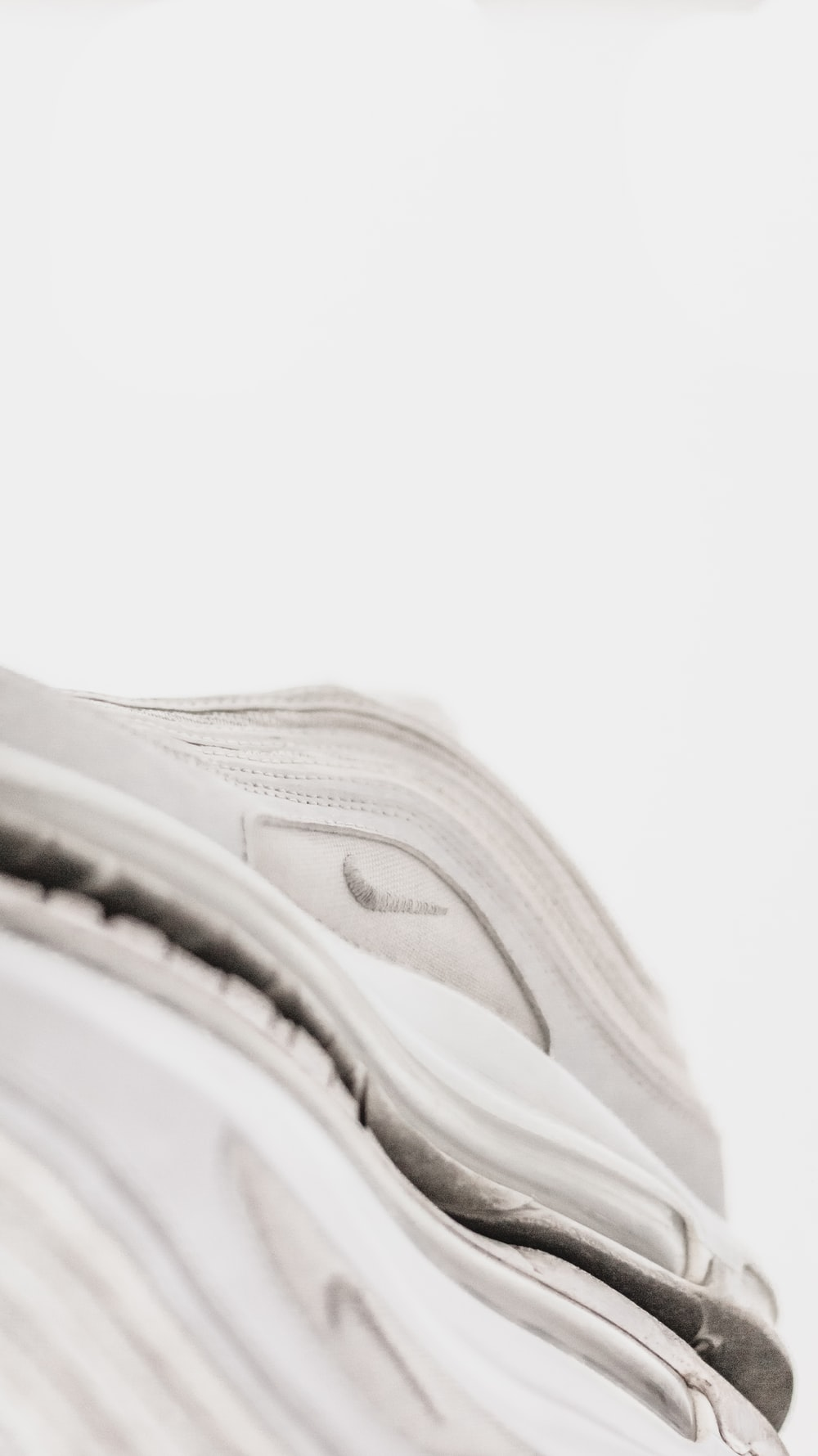 white and gray nike athletic shoes