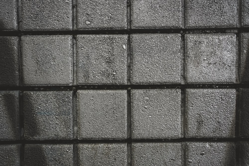 gray concrete wall with brown metal frame
