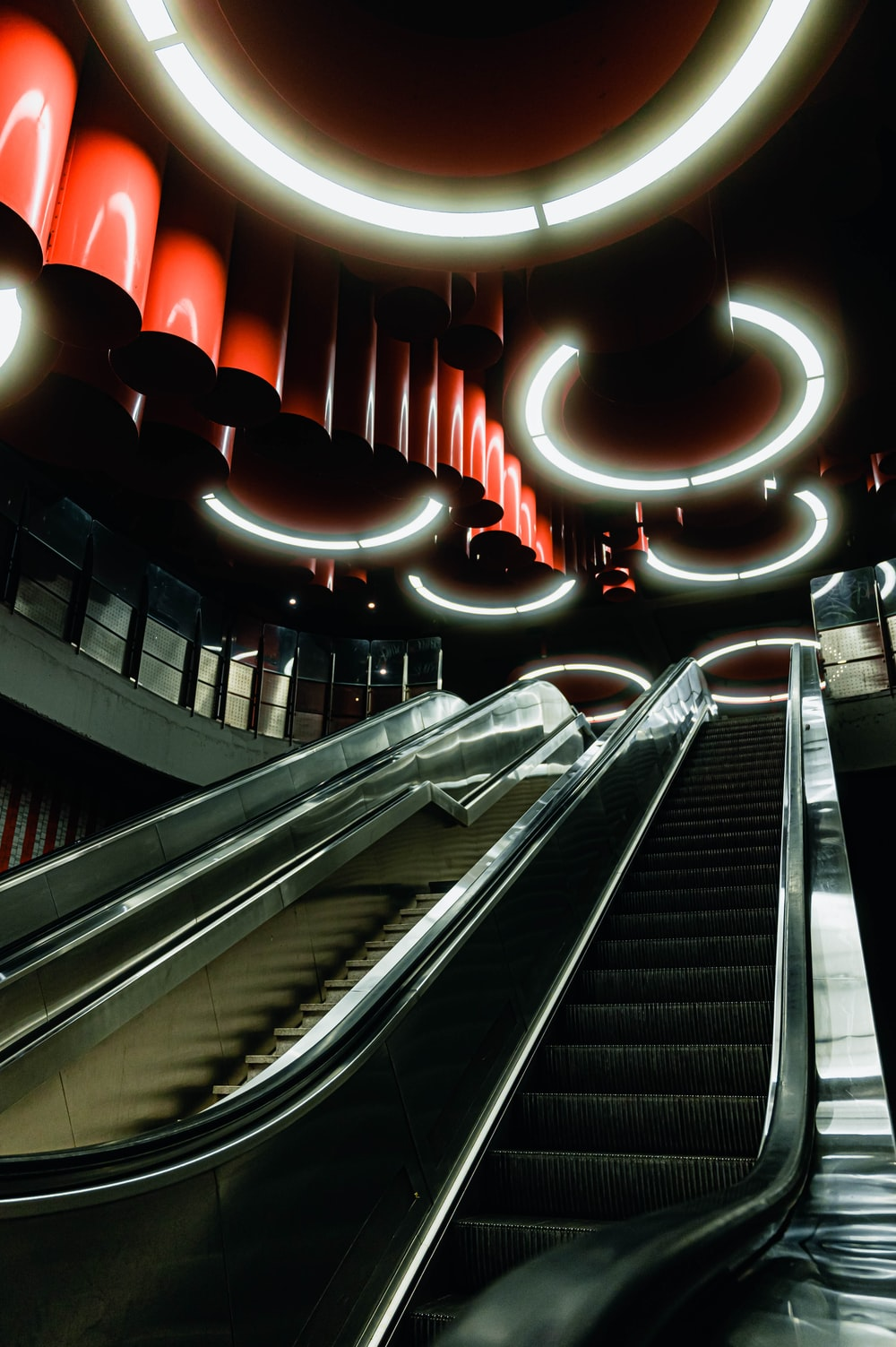 black escalator with red lights