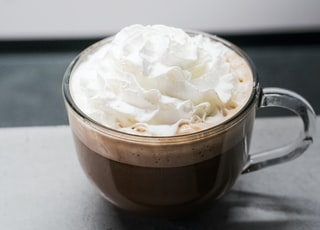white cream in clear glass mug