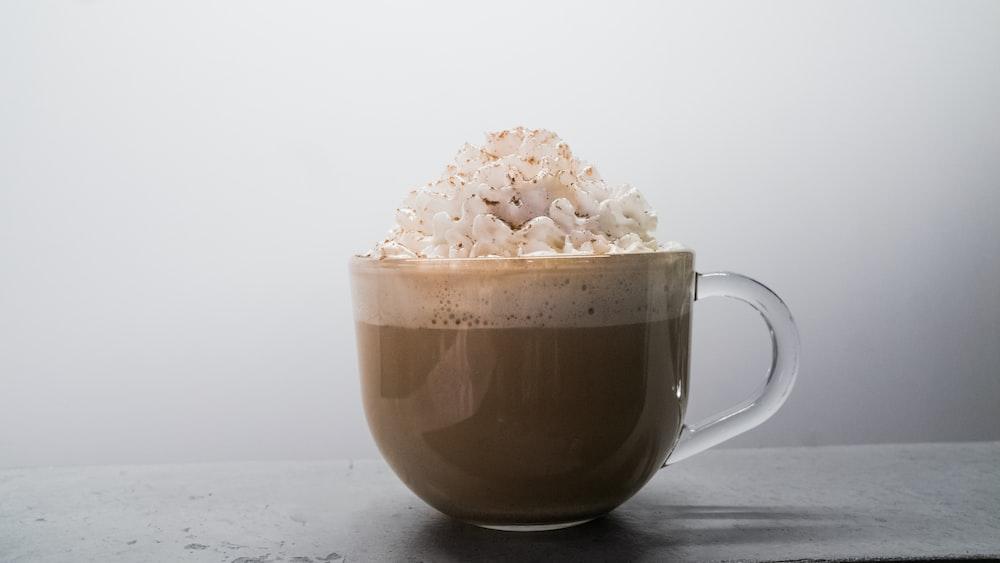 brown ceramic mug with white flower