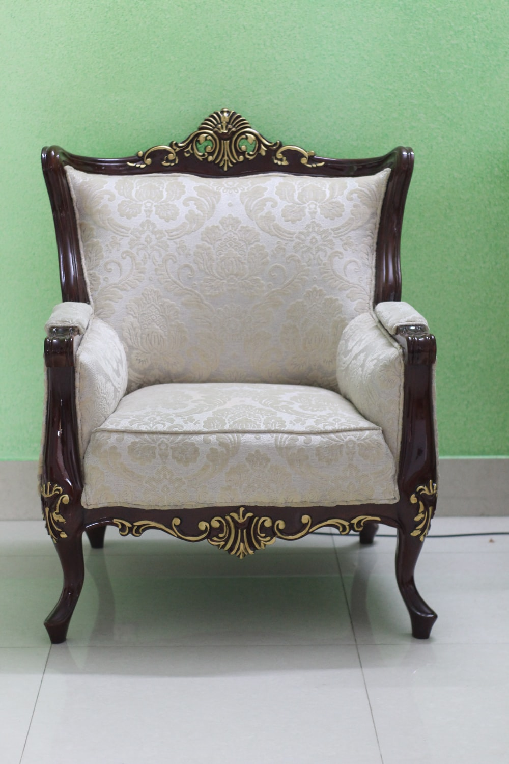 white and brown floral armchair