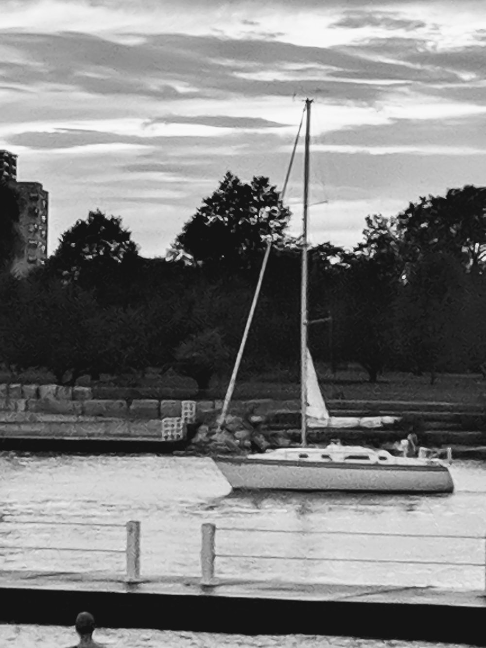 grayscale photo of sailboat on dock