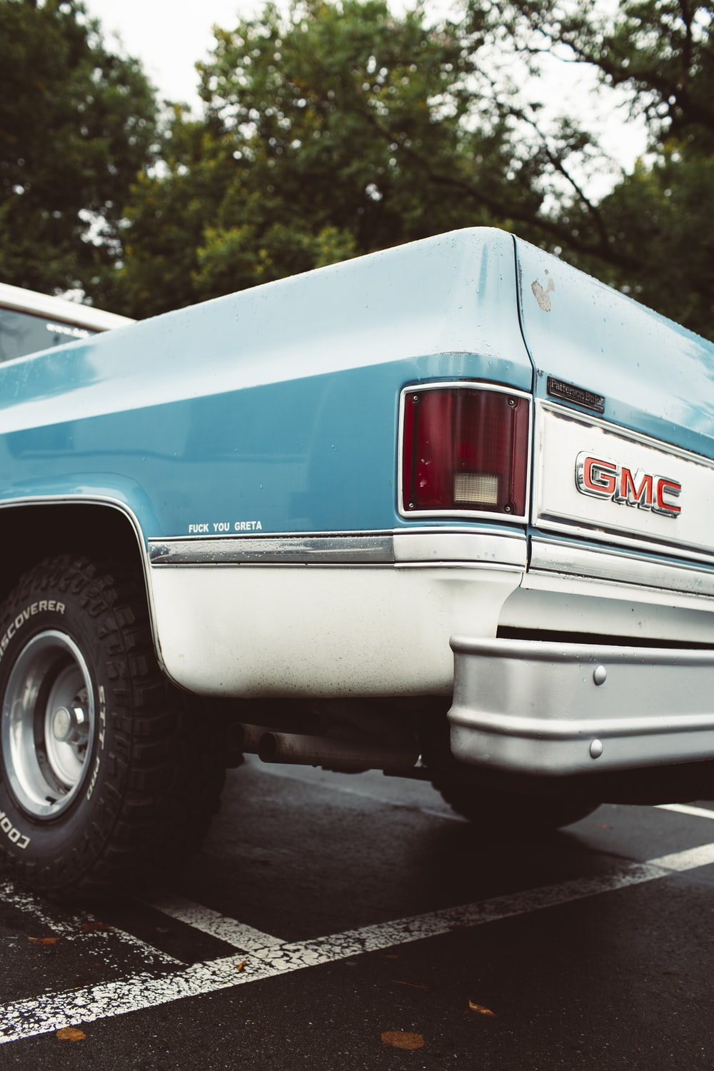 white and blue chevrolet crew cab pickup truck