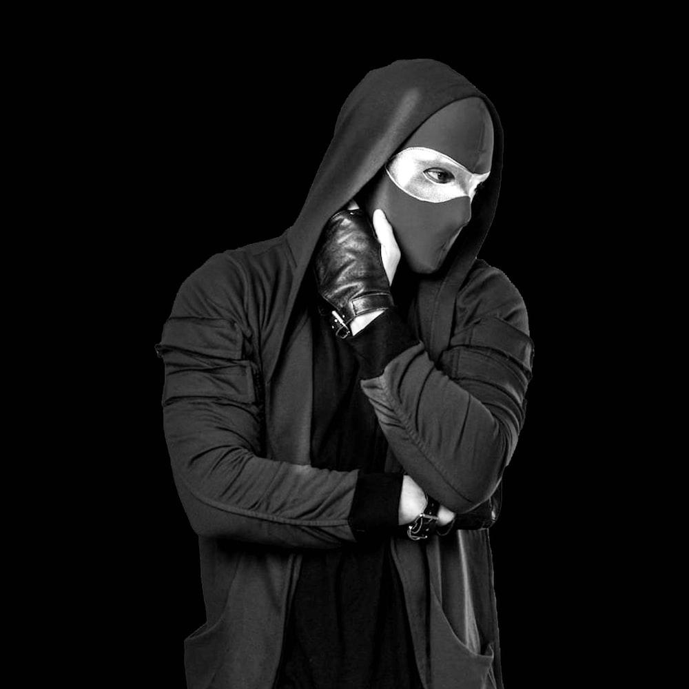 man in black coat wearing white mask