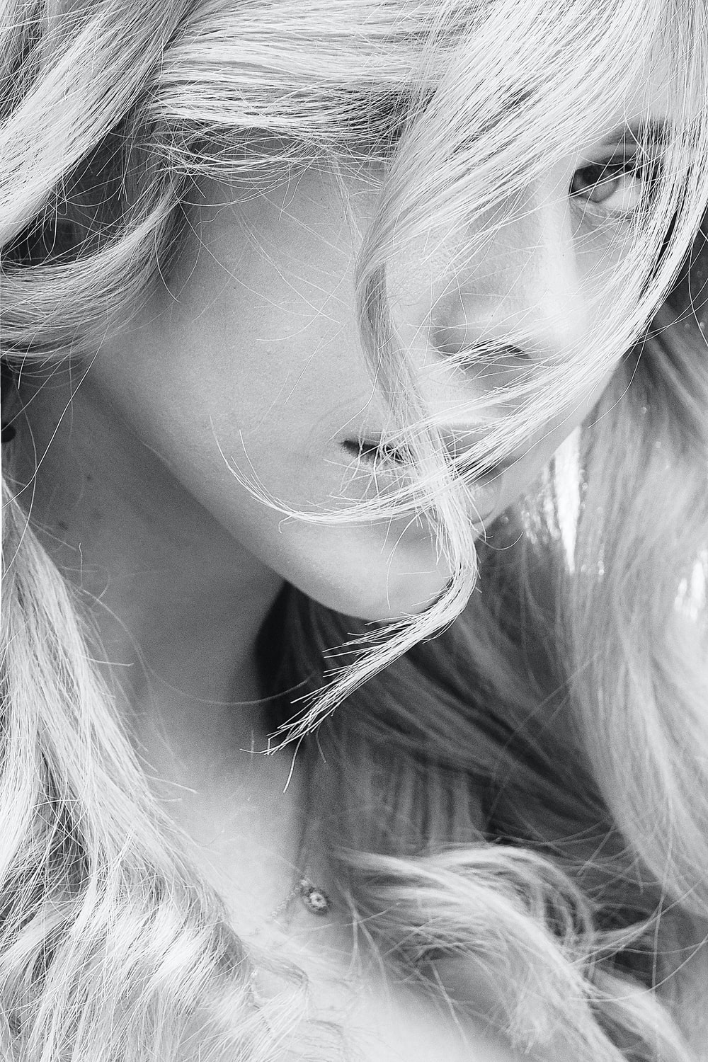grayscale photo of woman with blonde hair