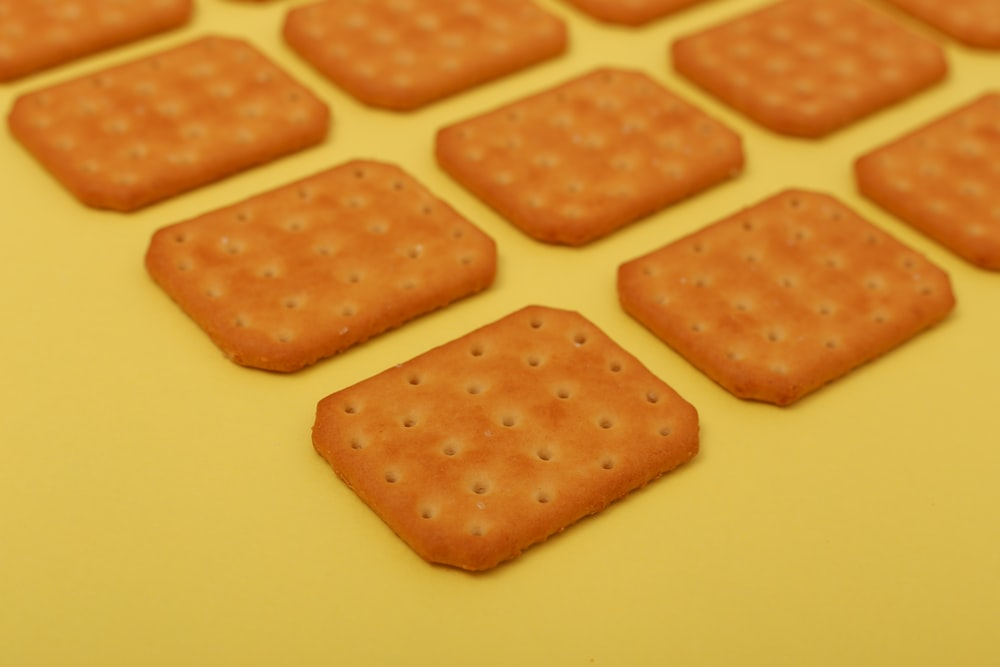 brown biscuits on yellow surface