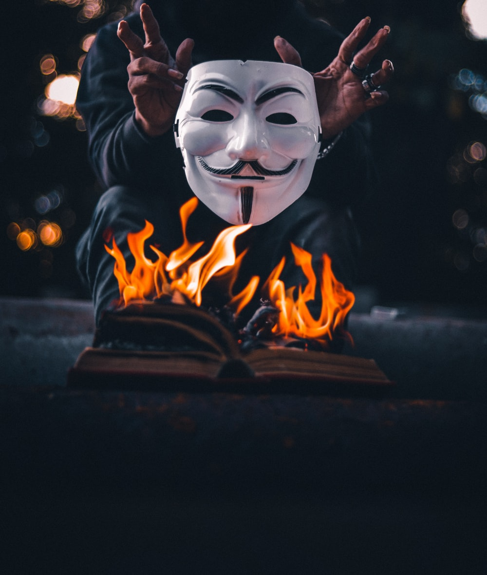 white and black mask with fire