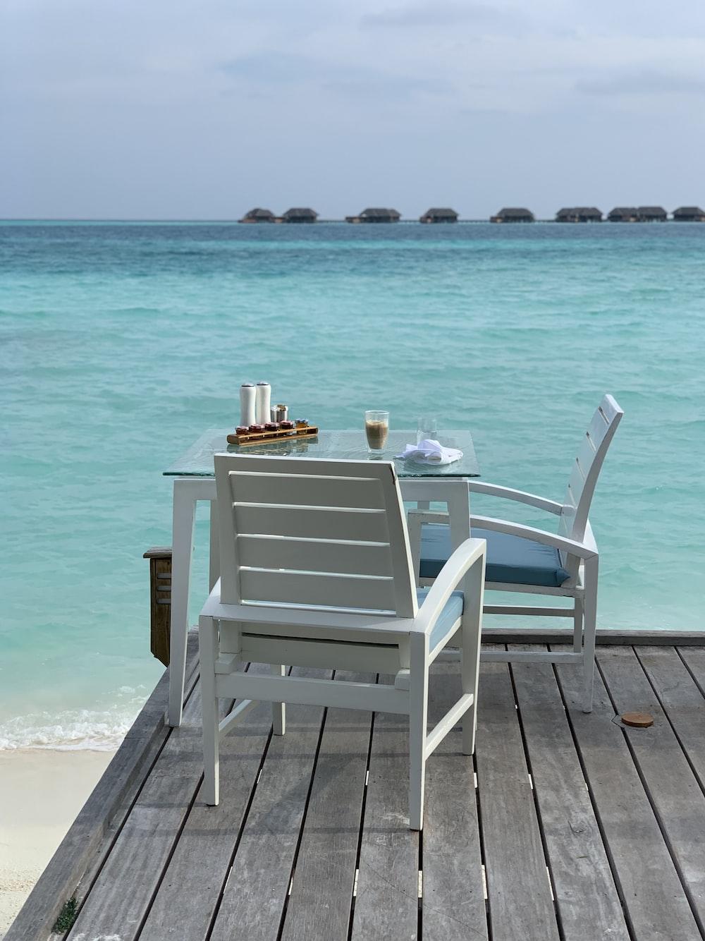 white wooden armchair on beach during daytime