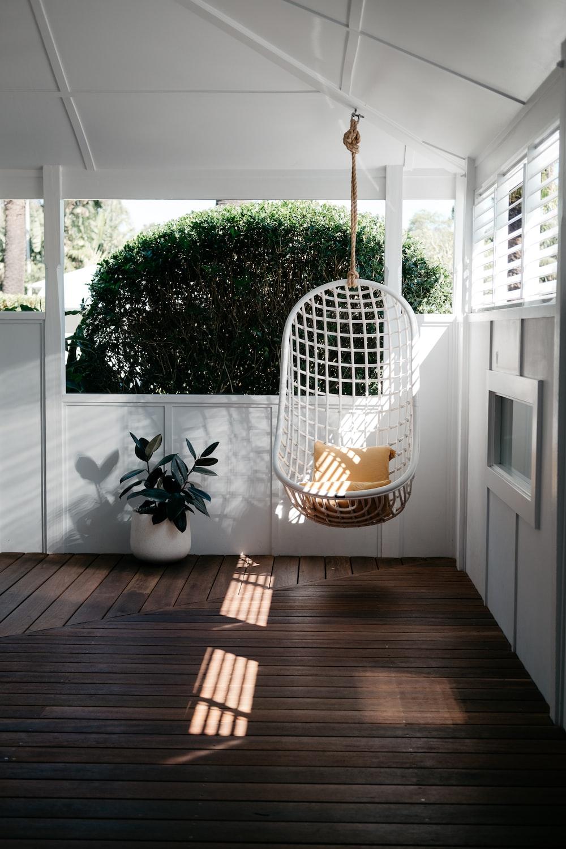 white bird cage on brown wooden floor
