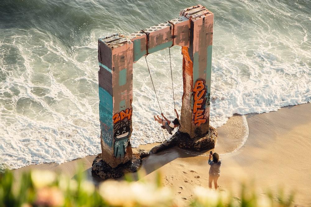 brown wooden ladder on seashore during daytime
