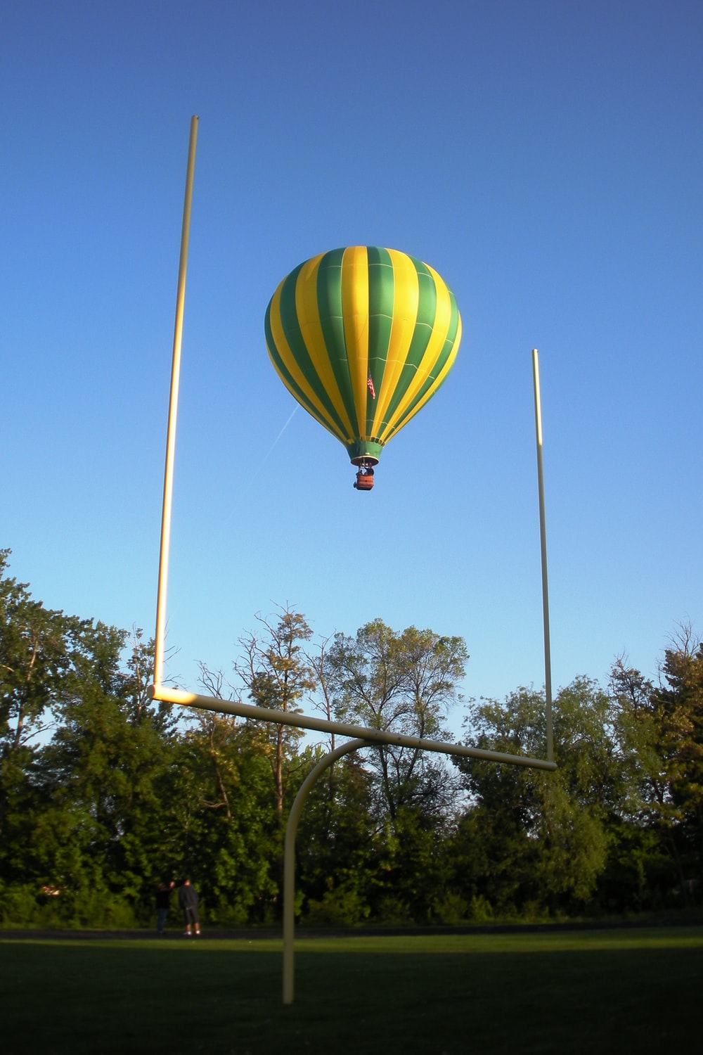 green yellow and blue hot air balloon on the air during daytime