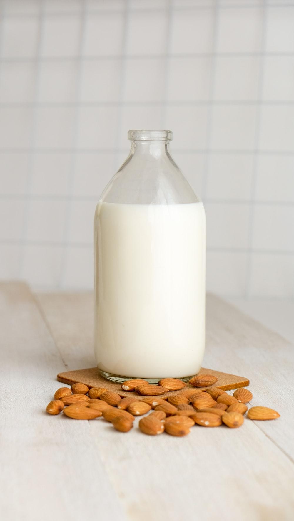 white milk in clear glass bottle