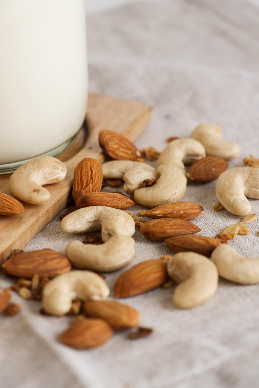 brown almond nuts on white textile