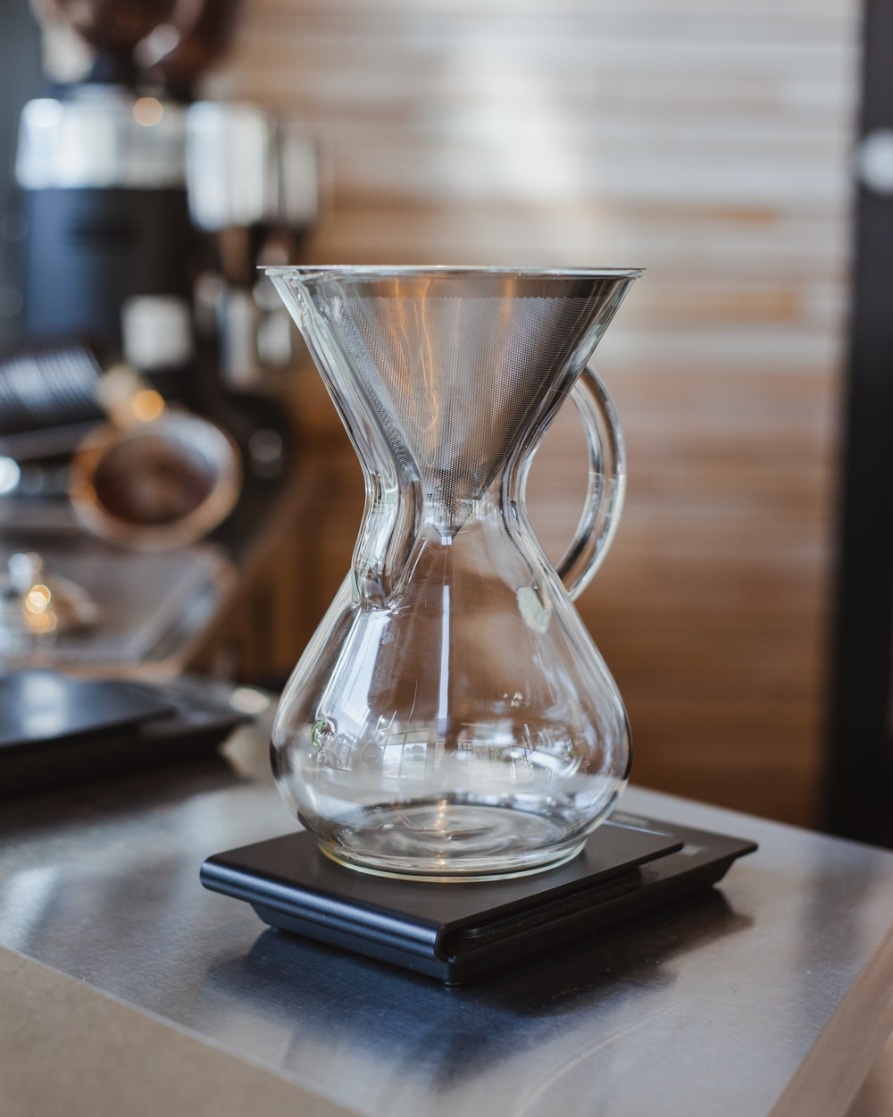 clear glass vase on black table