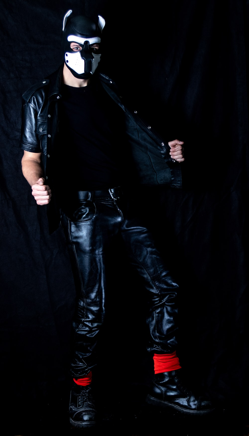 man in black leather jacket and black denim jeans