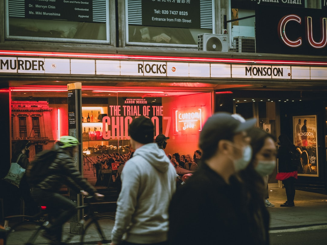People In Front of Red and White Store During Nighttime - unsplash