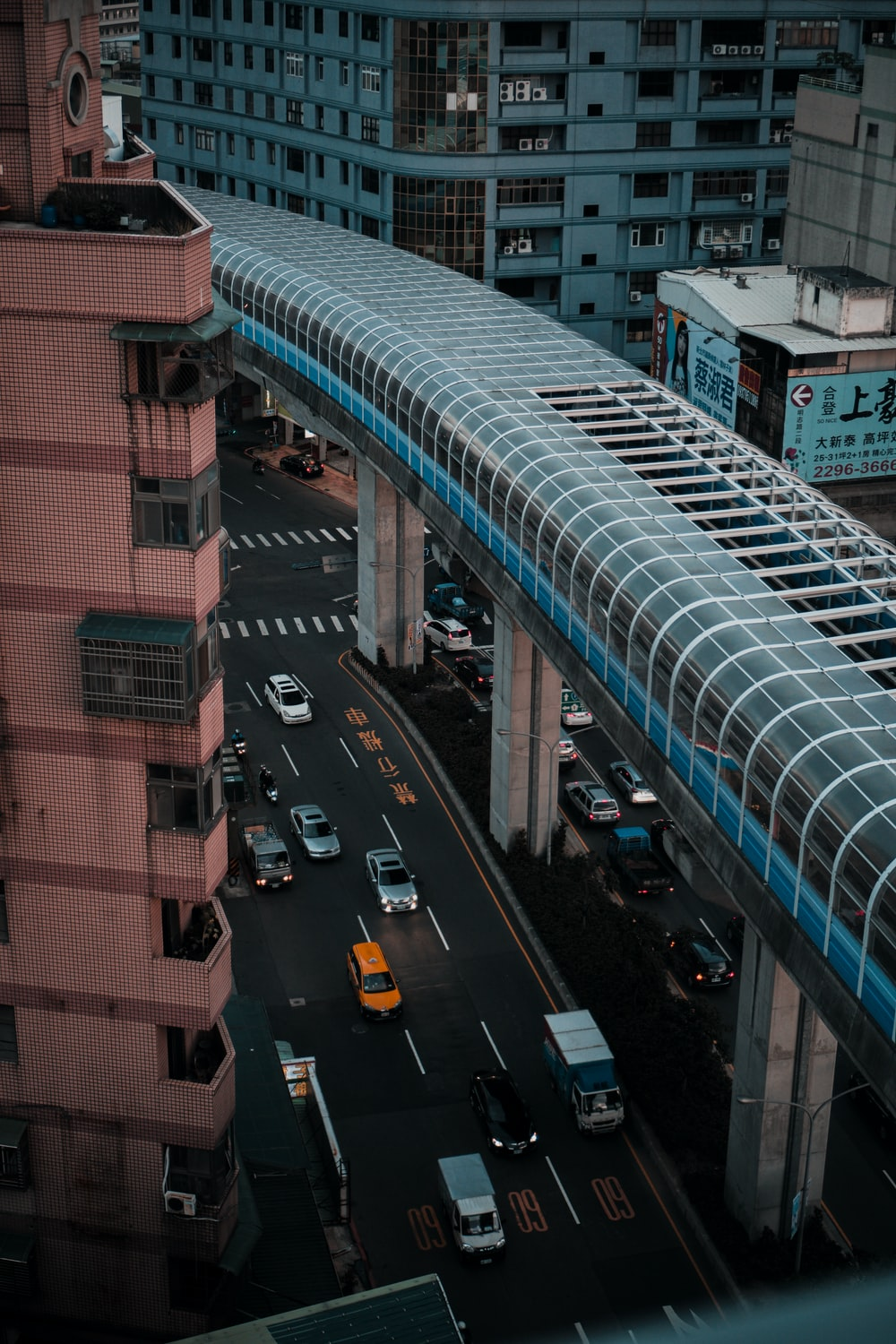 cars on road near building during daytime