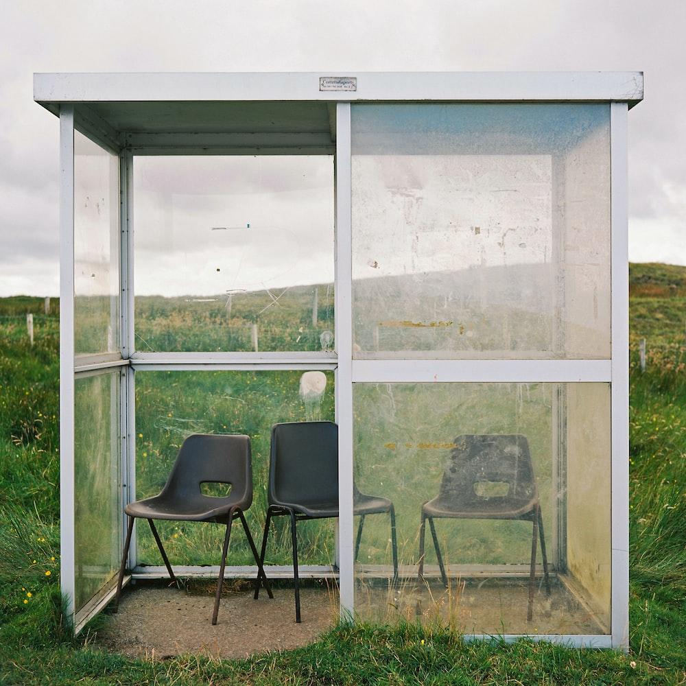 black chair beside glass window