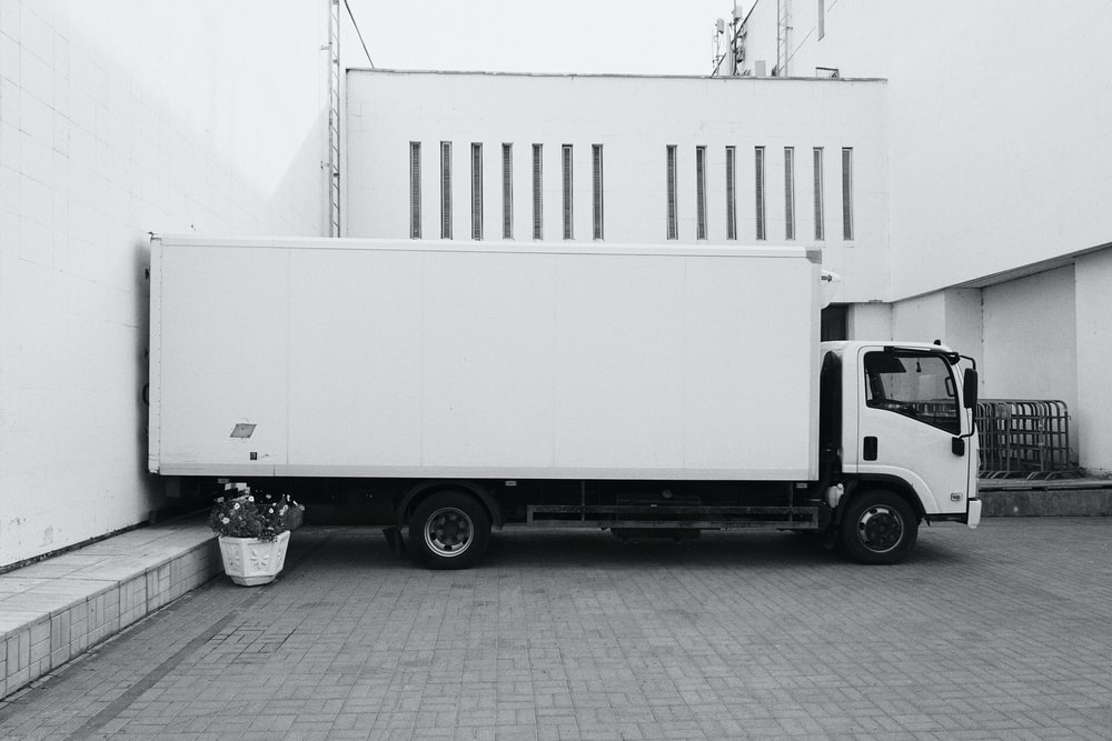 white truck parked near white building