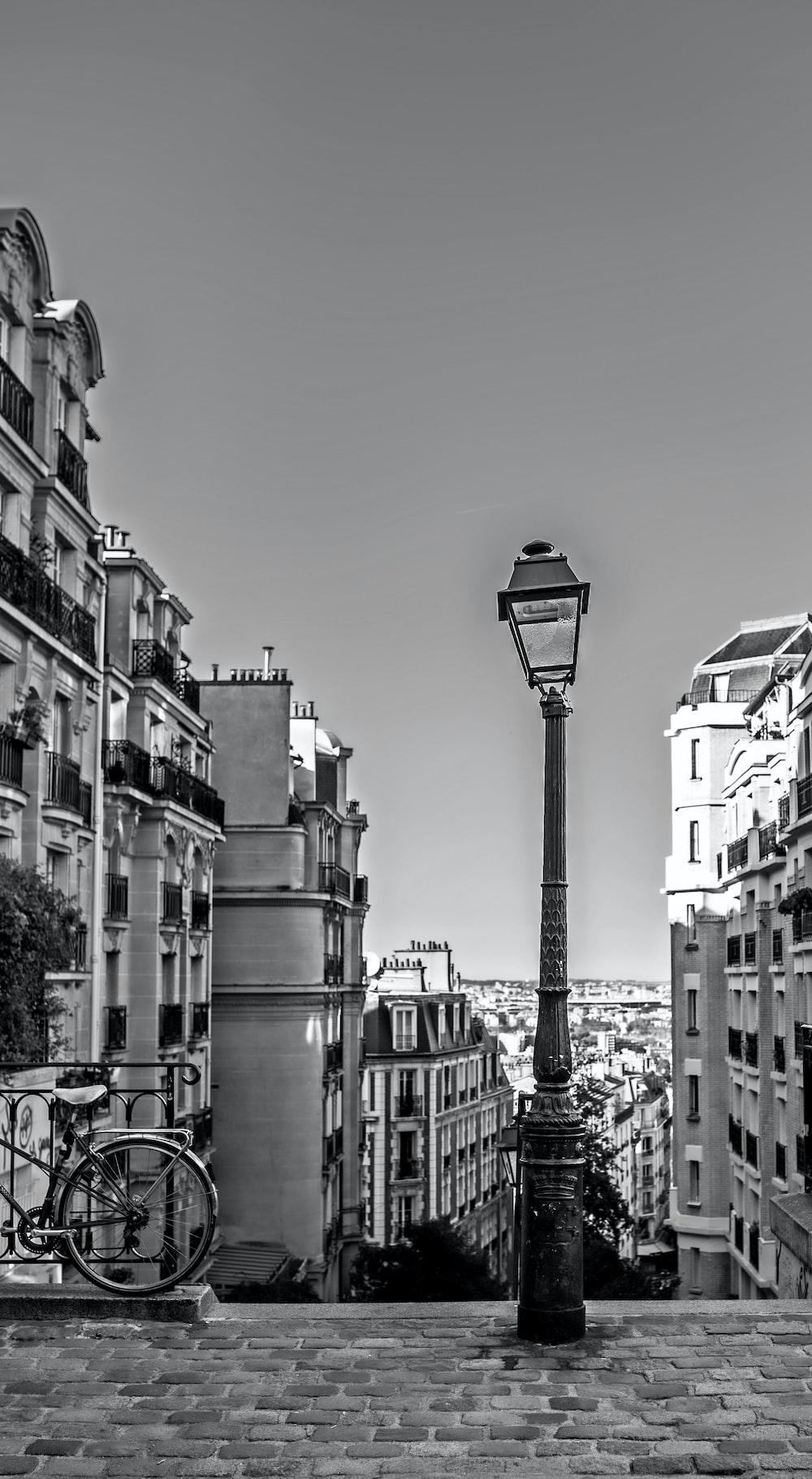 grayscale photo of street light near building