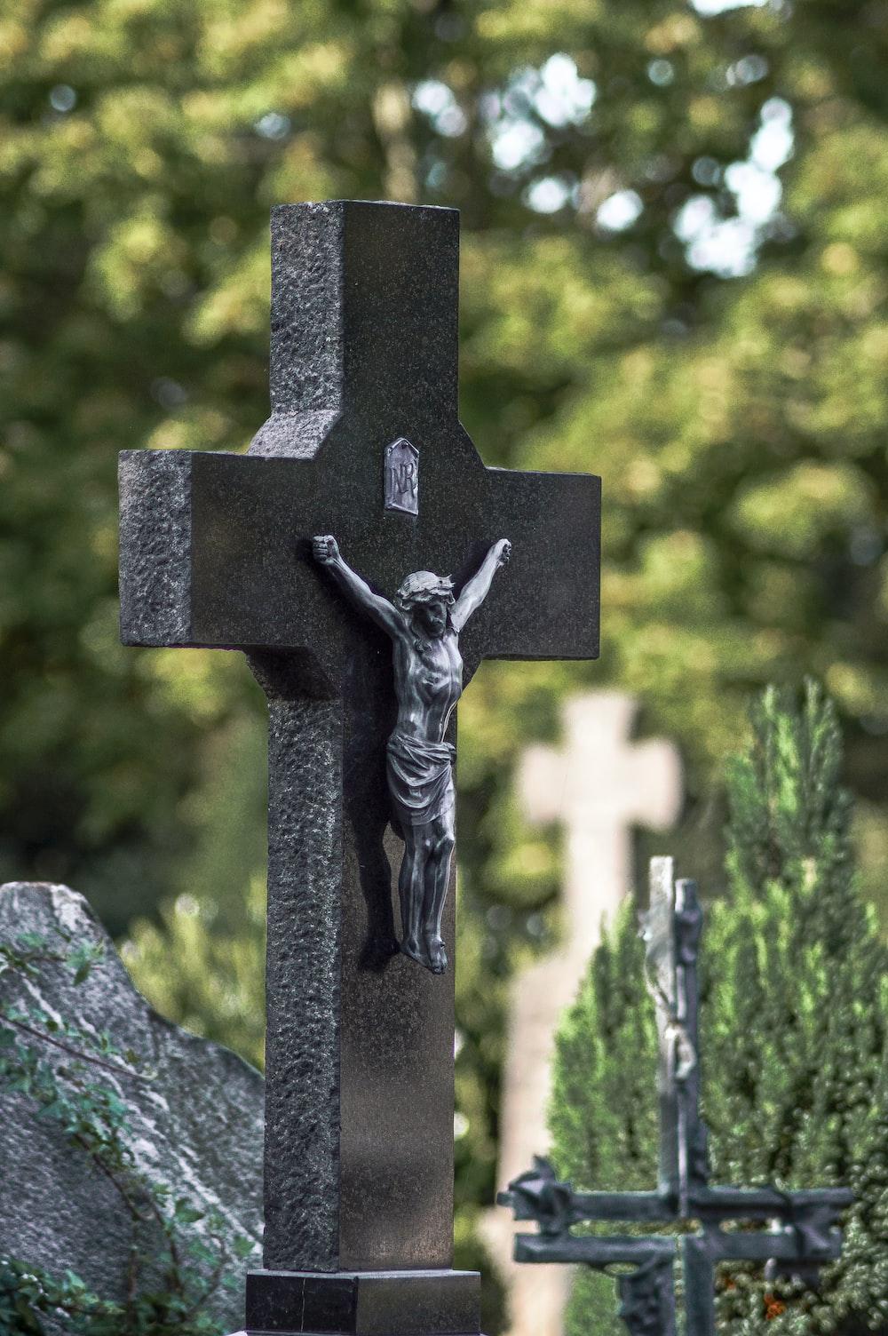 black cross on gray rock
