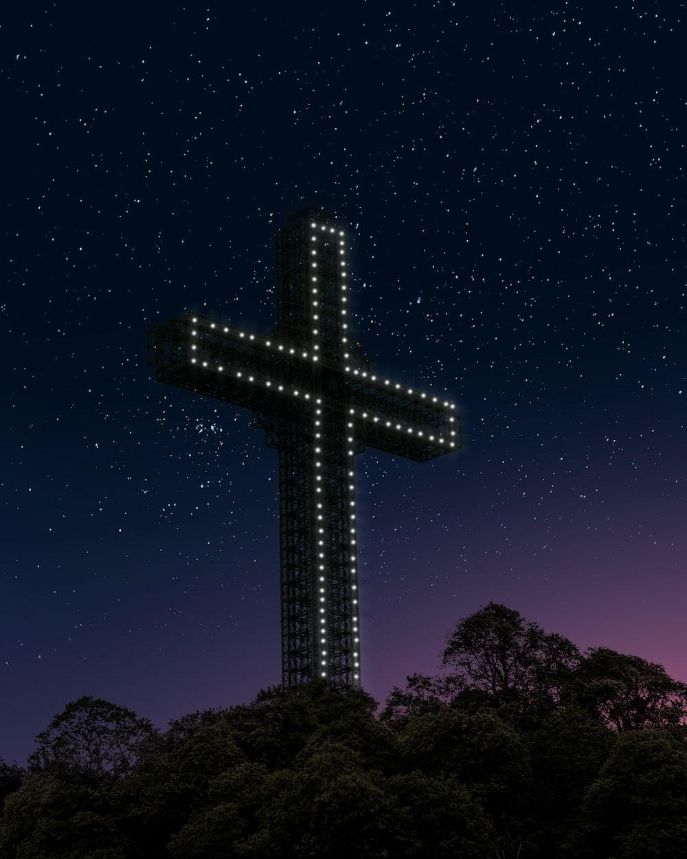 black cross under blue sky during night time