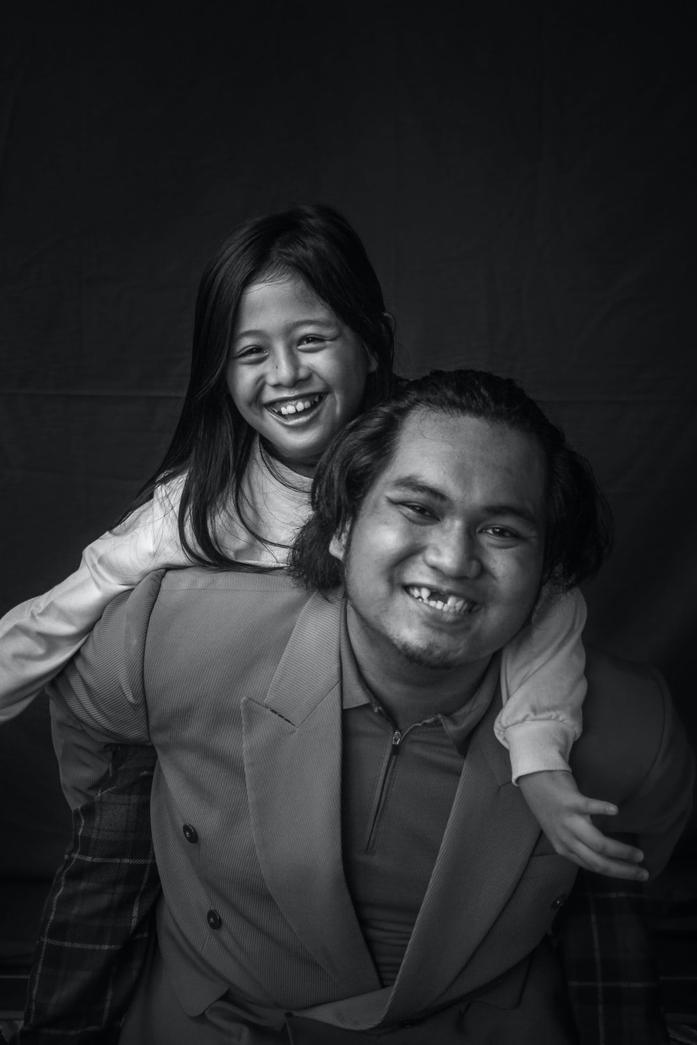 grayscale photo of man and woman smiling