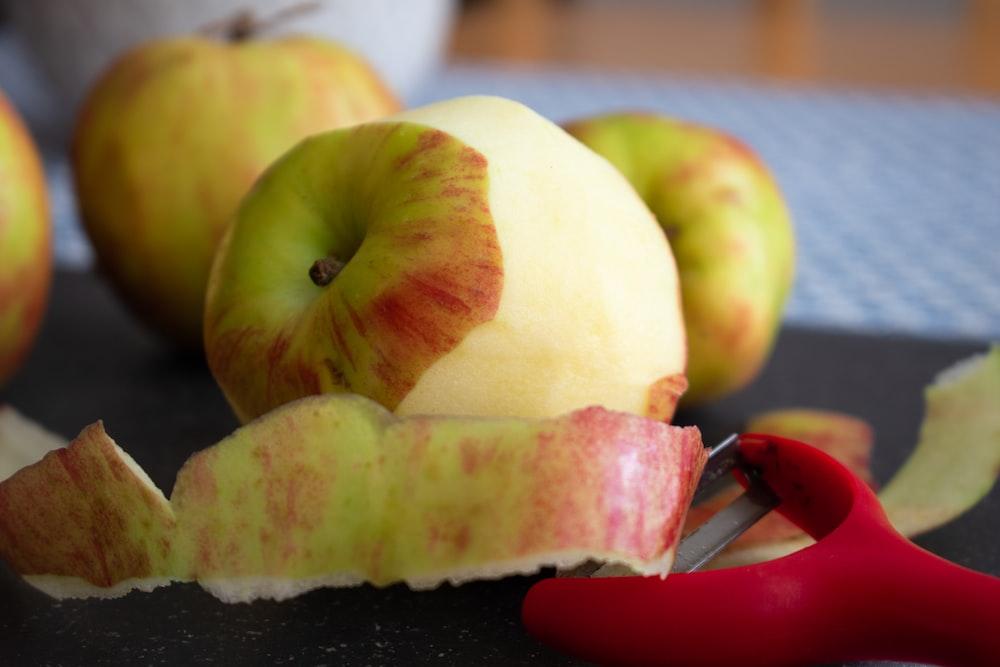 sliced apple fruit on black tray