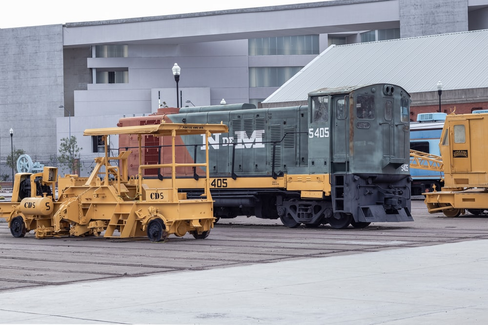 yellow and black train in a train station