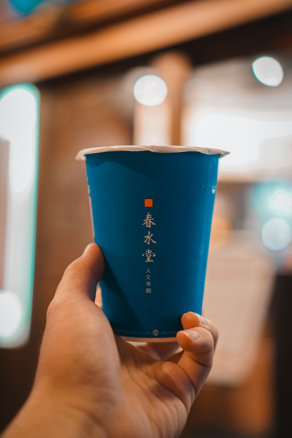 blue and white ceramic cup