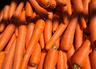 orange carrots on black surface