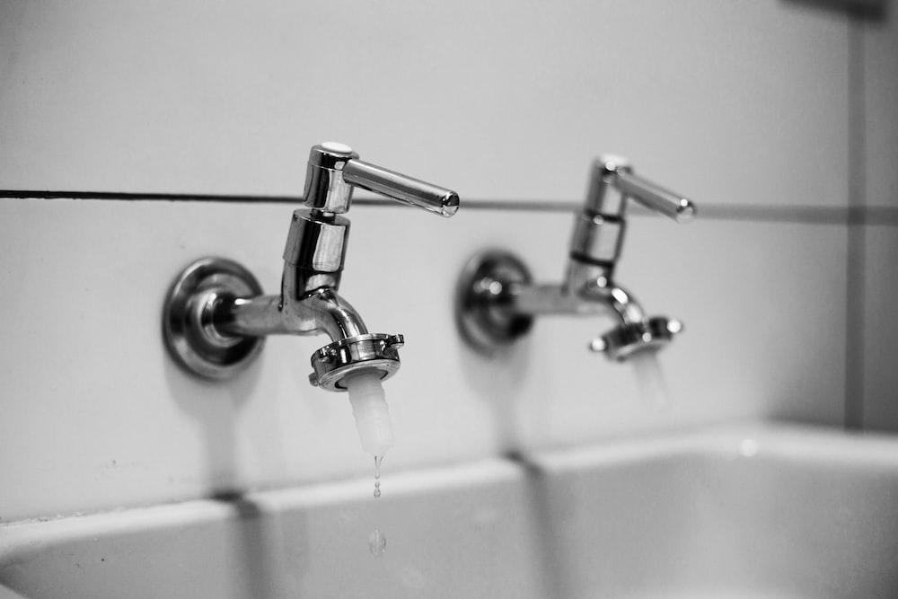 stainless steel shower head in white bathtub
