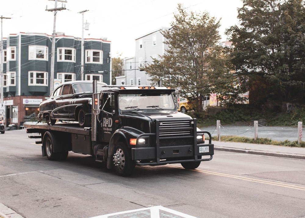 black truck on road during daytime