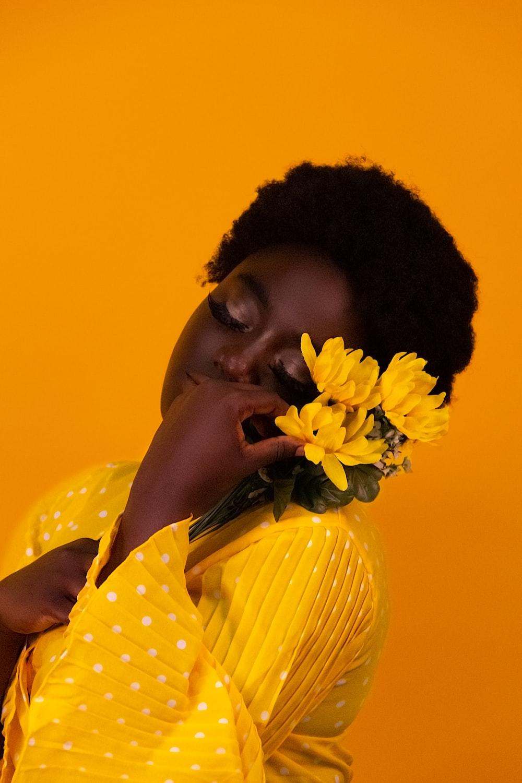 girl in yellow and white polka dot shirt