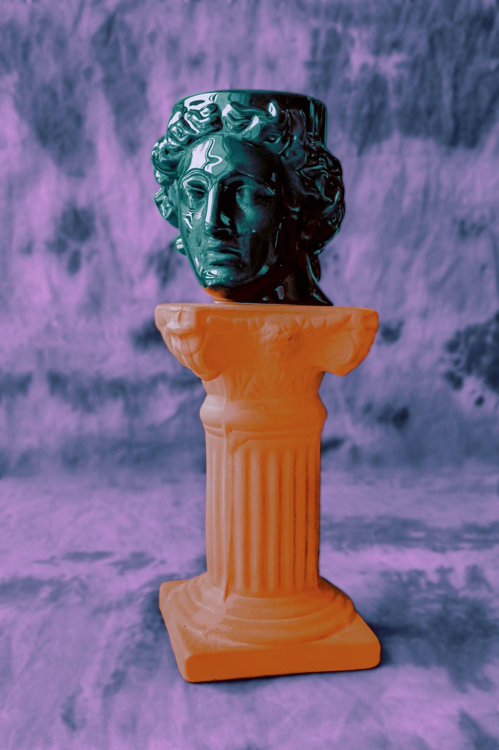white ceramic figurine on gray concrete stand