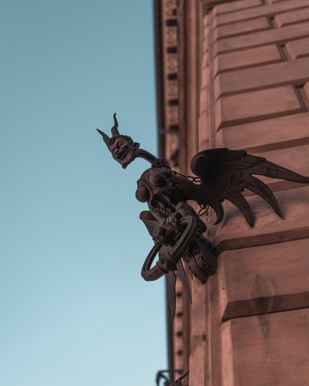 black dragon statue on brown concrete building during daytime