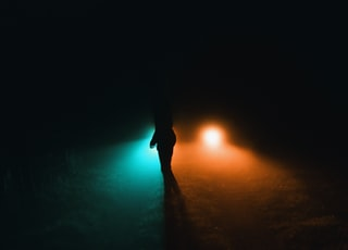 person walking on a dark room