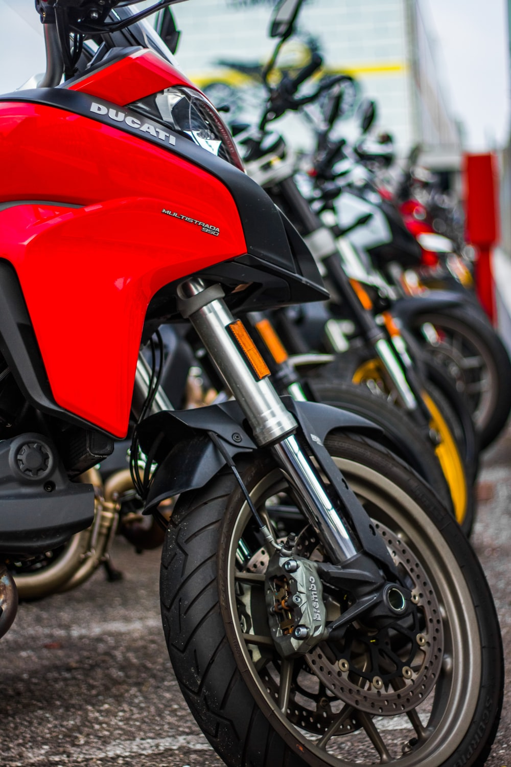 red and black motorcycle on road during daytime