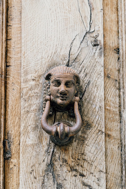 brown wooden door with lion door handle