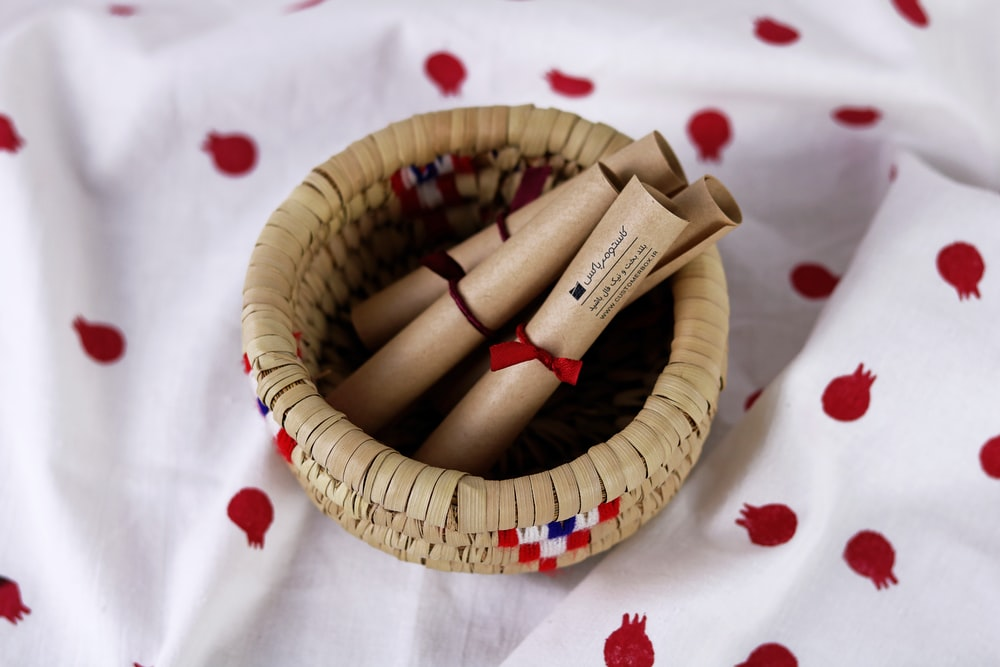 brown wooden sticks on brown woven round basket