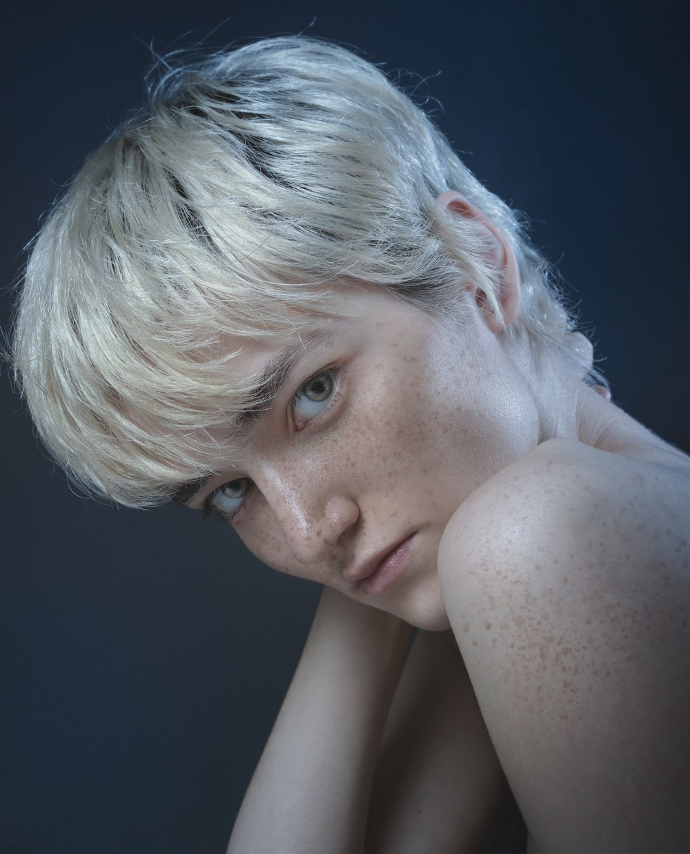 topless woman with blonde hair