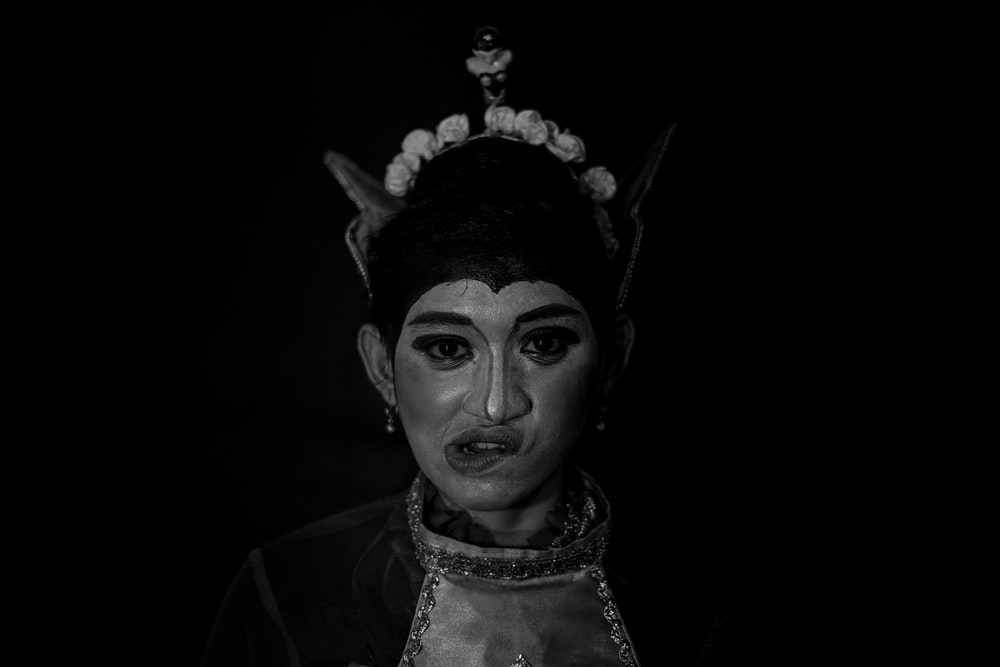 grayscale photo of woman wearing white and black floral head dress