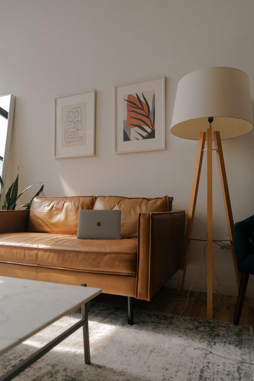 white leather sofa chair with white throw pillow