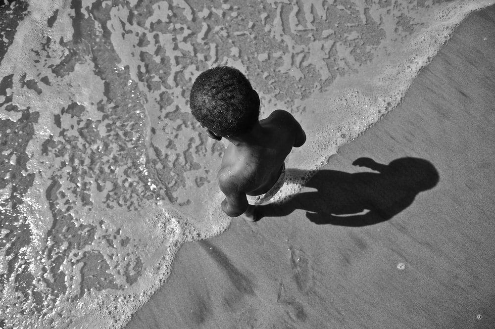 grayscale photo of man in water