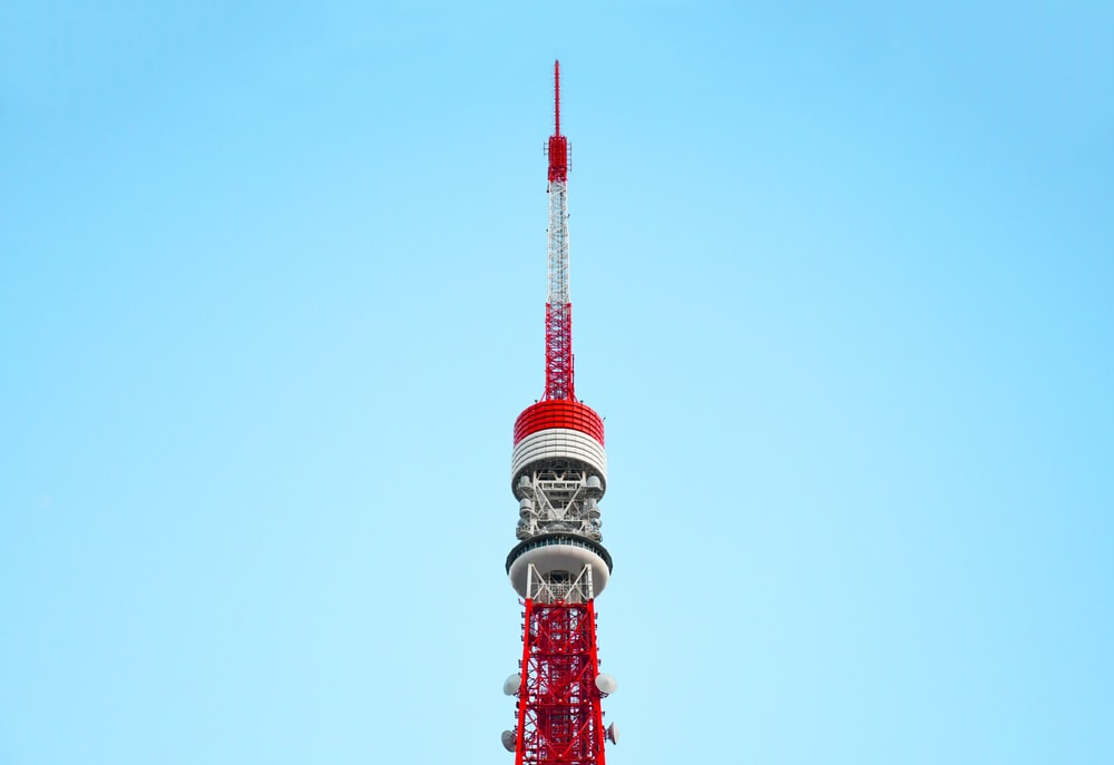 red and white tower under blue sky