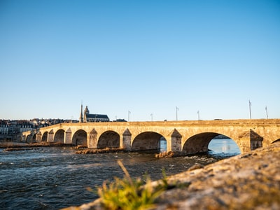 brown concrete bridge over water during daytime